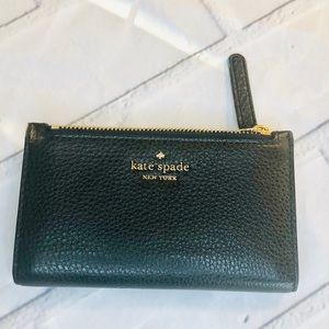kate spade black and gold wallet.